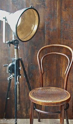 I love this lamp... perfect for that industrial rough luxe look...  unique, vintage, antique...