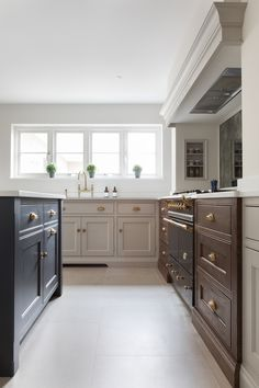 The Lacanche range cooker has a  Westin extraction unit housed in a false chimney overhead. The chimney niches provide a convenient space for herbs and spices and the splashback allows for keeping an eye on children and bouncing light back into the space. #humphreymunson