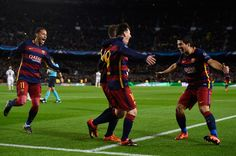 Lionel Messi (C) of Barcelona celebrates scoring his teams second goal with Neymar (L) and Luis Suarez (R) during the UEFA Champions League Group E match between FC Barcelona and AS Roma at Camp Nou on November 24, 2015 in Barcelona, Catalonia.