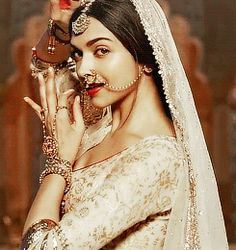 Deepika Padukone plays the role of a Rajput princess in Bajirao Mastani. Note the nath, the maangtika and the lovely delicate hathphool. Indian Celebrities, Bollywood Celebrities, Bollywood Actress, Bollywood Stars, Bollywood Fashion, Indian Bollywood, Bollywood News, Indian Dresses, Indian Outfits