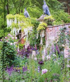 PRETTY PLANTING, Cottesbrooke Hall, design by award winning designer @arnemaynardgardendesign. Arne has used a lovely palette of pale pink  with dark purple plum colours which are a wonderful combination, including foxgloves, actaea simplex, astrantia, yarrow, poppies, salvia and climbing roses with a lovely white wisteria climbing the exposed brick wall. Photographed by Jonathan Buckley for @gardens_illustrated #englishgarden #gardensofinstagram #gardeninspiration #herbaceousborders…