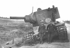 German troops posing in front of a wrecked KV-2 heavy Russian tank belonging to the 3rd Armored Division, June 1941. The (K)liment (V)oroshilov tank was a behemoth that could defeat all German anti-tank guns save the 88 Flak. The only way to defeat the KV was a direct hit to the rear. By 1942 though new German anti-tank weapons developed the ability to penetrate the KV's armor and the tank was phased out of service in favor of its Joseph Stalin successor.
