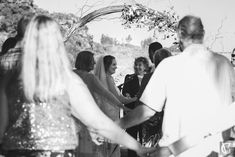 Everyone holding hands as a gesture to wish the bride and groom well