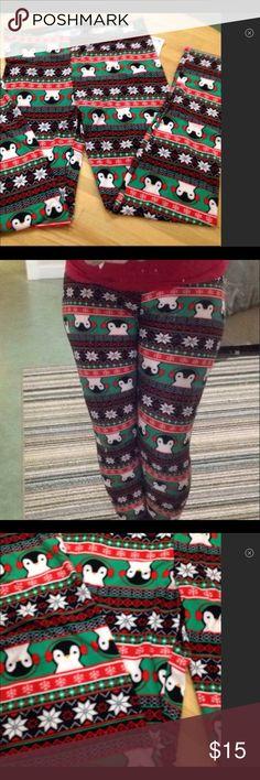 NWT Christmas Leggings Penguin Faces Soft adorable Christmas leggings with penguin faces. Very soft and adorable. Pants Leggings