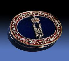 A RUSSIAN IMPERIAL PRESENTATION SNUFF BOX, Ca.1900, St Petersburg. Length 3 1/2 inches. Gold, Enamel & Jewels. Relatively recently sold at auction in NYC for $56,100.
