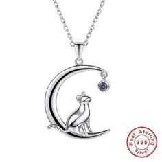 Silver Crescent Jewelry Cat Necklace $43.95 #cat #kitty #kitten #kittens #kitties #cutecat #mainecoon #meow #cats #catlover Gorgeous cat necklace features a cute cat sitting on a crescent moon. Made of 100% 925 sterling silver with unique details in design, this is the perfect item to perfect elegant style of cat lovers. FREE WORLDWIDE SHIPPING Extremely high demand: Shipping takes 2-4 weeks for US and 2-6 weeks for international delivery. DETAILS: Metals Type: 925 sterling Silver Material…