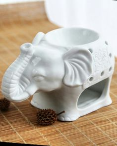 Ceramic elephant fragrance essential oil burner is available at Department Golden Pineapple Please PM/emails us for further Essential Oil Burner, Essential Oils, Fragrance Oil Burner, Ceramic Elephant, Man Icon, Oil Burners, Candle Holders, House Design, Elegant