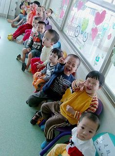 Some kiddos in Fujian take a break during their school day.  Looks like they love getting their picture taken!
