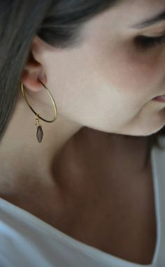 These brass hoops have a cool antique dagger piece!