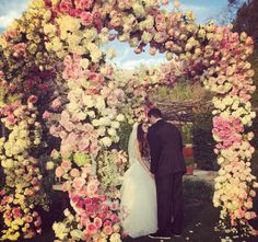 Sure, the first kiss at the #kimye wedding (in front of that crazy flower wall) is still the most-liked photo on Instagram, but Colorado Rockies pitcher Adam Ottavino married girlfriend Brette Wolff at California's San Ysidro Ranch this weekend, and the flowers at their wedding were some of the most over-the-top awesome that I've ever seen. I know this because I follow their wedding planner, Lisa Vorce, on Instagram. (Lisa also planned Chrissy Teigen and John Legend's Lake Como wedding and…