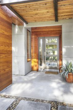 modern entry by MAK Design + Build Inc.