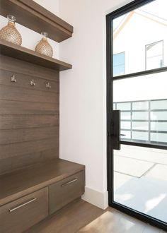 Form Meets Function In This Mudroom Which Feautures White Oak Cabinetry And  Low Profile Iron Doors