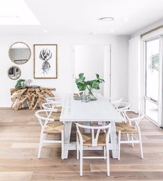 At Uniqwa we are loving this Australian Hamptons Style dining living room! Interior design by #stylemasterhomes. featuring furniture from Uniqwa Collections.... * Mandela Dining Table * Teakroot Console * Africa Wall Art * Lindi Mirrors Photography by #uniqwacollections