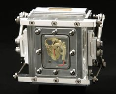 This 4″x5″ pinhole camera is made from aluminum, titanium, acrylic, formaldehyde and a human infant's heart.