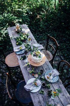 Lovely, vibrant dinner table in the woods.