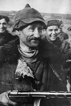 Partisan sniper Kuzma Zhakarov posing for the camera. Soviet Union, 1943