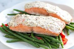 Easy 4 ingredient baked salmon recipe topped with a mixture of sour cream, mustard and parmesan cheese. Plus, how not to overcook salmon.