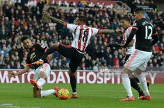 Manchester United's English defender Cameron Borthwick-Jacksonth (L) vies with Sunderland's English striker Jermain Defoe (2L) during the English Premier League football match between Sunderland and Manchester United at the Stadium of Light in Sunderland, northeast England on February 13, 2016. / AFP / OLI SCARFF / RESTRICTED TO EDITORIAL USE. No use with unauthorized audio, video, data, fixture lists, club/league logos or 'live' services. Online in-match use limited to 75 images, no video…