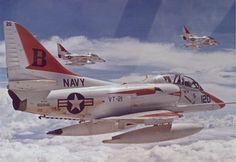"""USN TA-4F Skyhawks of VT-21, """"Redhawks"""" . . ."""