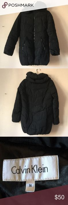 Calvin Klein black puffer jacket Works great to keep you warm in the colder days of winter. However, this design has no hood so it might be necessary to purchase a hat to keep your ears warm if you desire. The paint from the zippers has peeled off but otherwise it's in good condition. No rips or spots on it.  Downsizing my closet and I haven't worn this one in a while. Calvin Klein Jackets & Coats Puffers