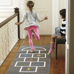 Shop Kids Hopscotch Rug.  You don't have to wander far to find a uniquely designed hopscotch rug.  Our Hopscotch Rug is available right here.  It even includes two beanbags for even more games to play.