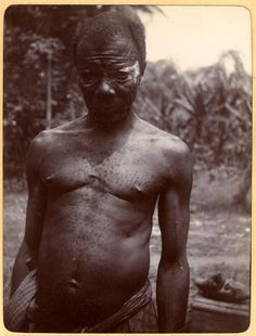 Photograph (black and white) from an album; portrait of a man; Idiong-master (medicine man) with white pigment around his eyes; wearing lower garment. Ukpum-uwana, Nigeria, 9th February 1905.  Gelatin silver print