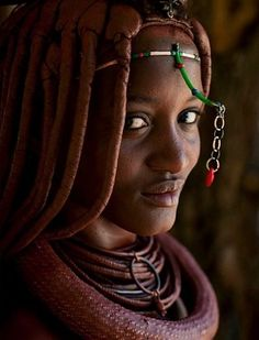 Angolan Himba woman.The Himba people belong to the Bantu Herero family group, their homeland is presently divided and spread through Angola, Namibia and Botswana. A great number of Himba still preserve the ancestral ways of living, Their culture is intimately linked to their livestock life cycle.I find the Himba to be gifted with an extraordinary elevated natural beauty. This Photo is  by Eric Lafforgue in http://www.angolabelazebelo.com