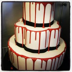 Red dripped wedding cake. Need to try with strawberries on top!