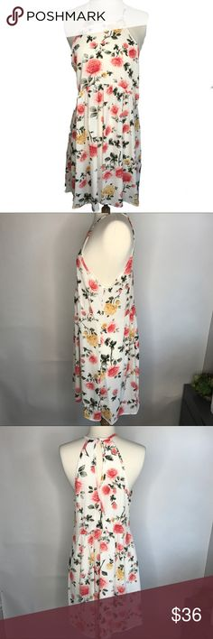 "Floral Mini Dress Sweet dress; perfect for casual weddings or summer parties. High low hem. Polyester & spandex. Made in USA. Fits up to approximately 38"" bust. Length approximately 30"". mockingbird + poppy Dresses Mini"