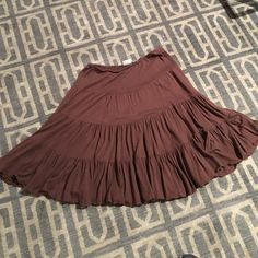 ‼️‼️FINAL PRICE DROP‼️ Brown Skirt FINAL PRICE DROP!!      Cute, Soft, light feeling and comfortable brown skirt. Rayon and cotton. Perfect for a spring or summer casual fun day. Elastic waist that can stretch . In good used condition, no rips, tears, stains. Hangs at 20 inches from the waistband. Skirts