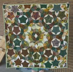 A quilt made with Penrose tiling piecework by domesticat, via Flickr