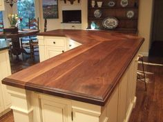 Waterlox coat on butcher block counter.  Soft and beautiful.