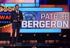 Patrice Bergeron of the Boston Bruins accepts the Frank J. Selke Trophy during the 2015 NHL Awards at MGM Grand Garden Arena on June 2015 in Las Vegas, Nevada. Nhl Awards, Patrice Bergeron, Wells Fargo Center, Mgm Grand Garden Arena, Philadelphia Flyers, Boston Bruins, Nevada, Las Vegas, First Love