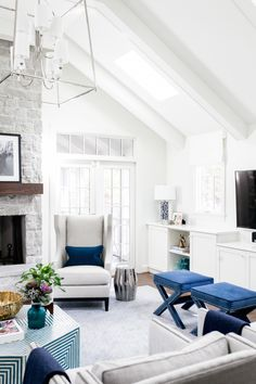Gray seating and navy accented stools: http://www.stylemepretty.com/living/2016/11/25/the-5-reasons-you-should-be-designing-with-white/ Photography: Catherine Truman - http://www.catherinetrumanphoto.com/