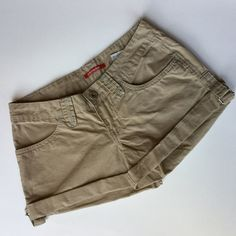 Union Bay Shorts. Cute Khaki shorts  Union Bay Shorts in size 3. Khaki shorts with light blue green stitching. Great shape. Ready for spring. Color on blue green background is accurate. Side buckle to hold cuff in place. Union Bay Shorts
