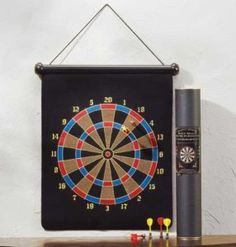 Picture of Magnetic Dart Board. A wide variety of fun games of skill can be played using this safe, magnetic dart board set. Board constructed of rubber, steel and velvet. x 1 x 27 high.