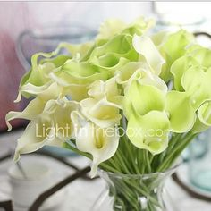 10 Heads Real touch Calla Lily Tabletop Flower Artificial Flowers - USD $8.65 ! HOT Product! A hot product at an incredible low price is now on sale! Come check it out along with other items like this. Get great discounts, earn Rewards and much more each time you shop with us!