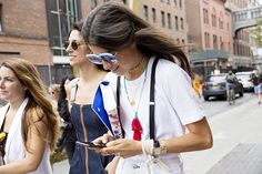 The Best Beauty Street Style From NYFW Spring 2016: Leandra Medine's suspenders, tassel necklace and square sunglasses   allure.com