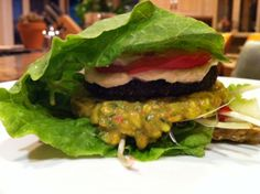 Raw Veganator Burger. Click here to see the full recipe - http://www.youngandraw.com/2011/12/04/tastes-real-rawburger-with-chipotle-mayo-chunky-guacamole/ #raw #vegan #burger #recipe