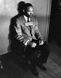 Martin Luther King Jr. sitting quietly for a mug shot after his arrest in Montgomery, Alabama, for directing citywide boycotts of segregated buses in 1956. | 26 Famous People From History Like You've Never Seen Before