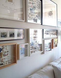 Gallery-style wall of shadow boxes filled with trip memories