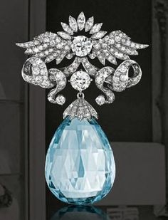 Verdura looked to religious and military symbols for inspiration, deriving winged motifs from both. The platinum mounting contains over 11 carats of diamonds and suspends a fine briolette aquamarine. Made in 1960.