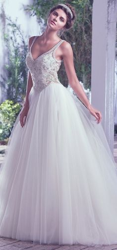 """Be still my heart!  """"Tiana"""" by @maggiesottero gets all our hearteyes! Romance meets drama in this generously beaded lace bodice, featuring illusion side panels before flowing out into a grand tulle ball gown skirt. #bridal #wedding #weddingdress #weddinggown #bridalgown #dreamgown #dreamdress #engaged #inspiration #weddinginspiration #weddingdresses #romantic #maggiesottero #maggiebride #ballgown"""