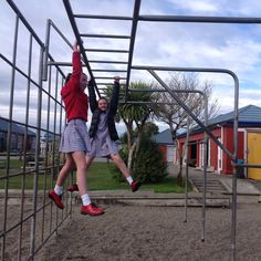 The monkey bars are parallel and perpendicular lines with people having fun at SGHS