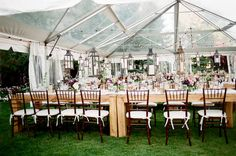 Farm Tables, Chaivari Chairs & Hanging vintage lanterns in a clear top tent