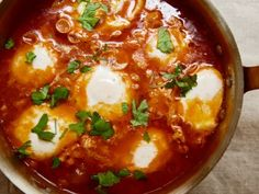 For those with a passion for runny yolks, it doesn't get much better than Shakshuka, that Middle Eastern dish of eggs poached in a spiced tomato sauce.  Of course, there is one way to improve on the dish and that would be by adding chunks of Moroccan merguez à la this: Moroccan Merguez Ragout with Poached Eggs from Amanda Hesser's and Merrill Stubbs' The Food52 Cookbook.