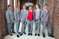 Groomsmen in grey suits with lavender vests & a groom with red | Amanda & Colton's offbeat, personalized Virginia wedding at the Workhouse Arts Center | Image: Amanda Dorian Photography