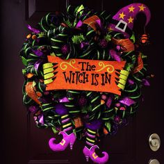 The Witch Is In deluxe deco mesh Halloween wreath with glittery witch legs and hat by BeccasFrontDoorDecor on Etsy https://www.etsy.com/listing/207439100/the-witch-is-in-deluxe-deco-mesh