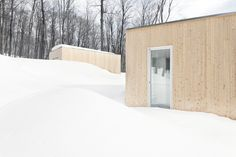 Image 6 of 21 from gallery of Blue Hills House / la SHED architecture. Photograph by Maxime Brouillet La Shed Architecture, Residential Architecture, Cedar Siding, Blue Hill, White Cedar, House On A Hill, Window Film, Wooden Walls, Glass Door