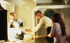 Director James Cameron, Leonardo DiCaprio and Kate Winslet on the set of Titanic (1997).